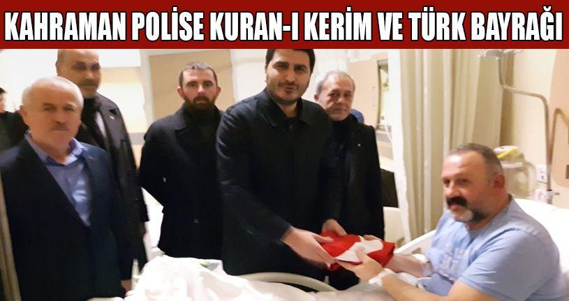 MHP'lilerden Kahraman polise Kuran-ı Kerim ve  Türk Bayrağı
