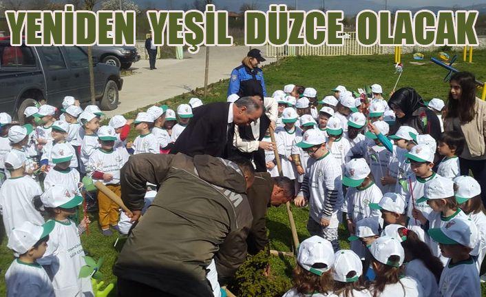 Bin 200 fidan toprakla buluştu
