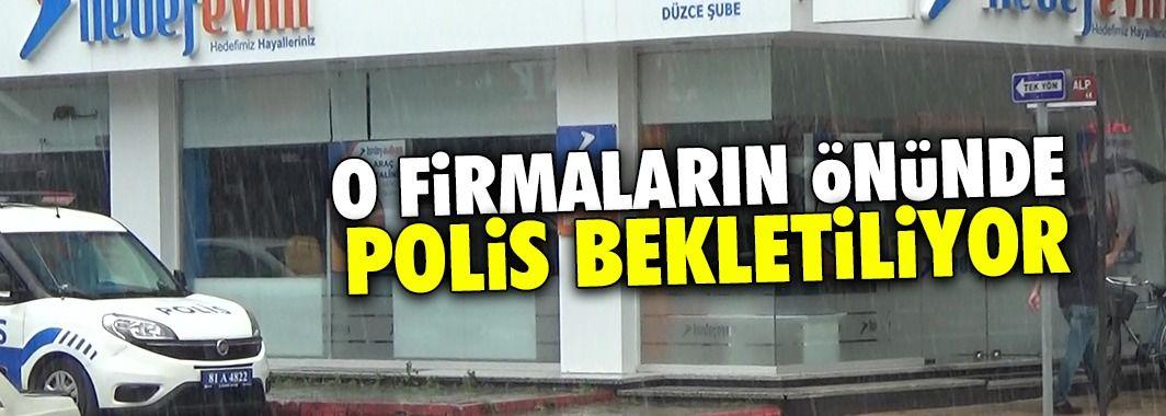 Tasfiye edilen firmaların önünde polis bekletiliyor