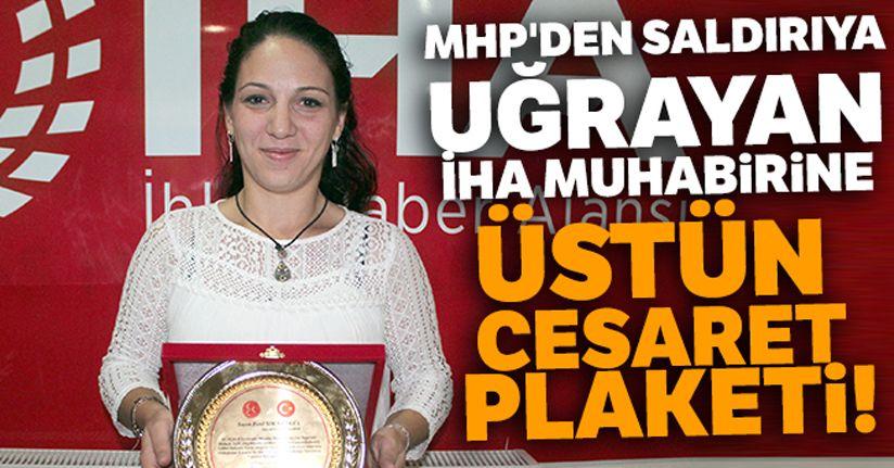 MHP'den saldırıya uğrayan İHA muhabirine üstün cesaret plaketi